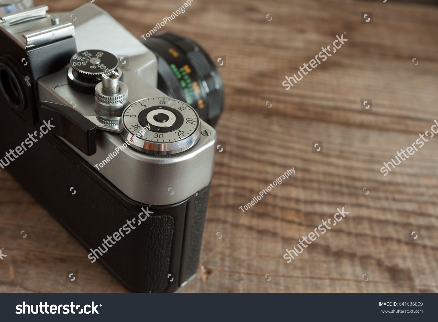 vintage film camera lying over dated stock photo edit now