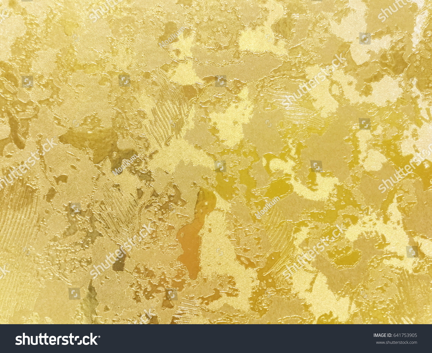 Abstract gold color painted on grunge rough surface of stucco ...