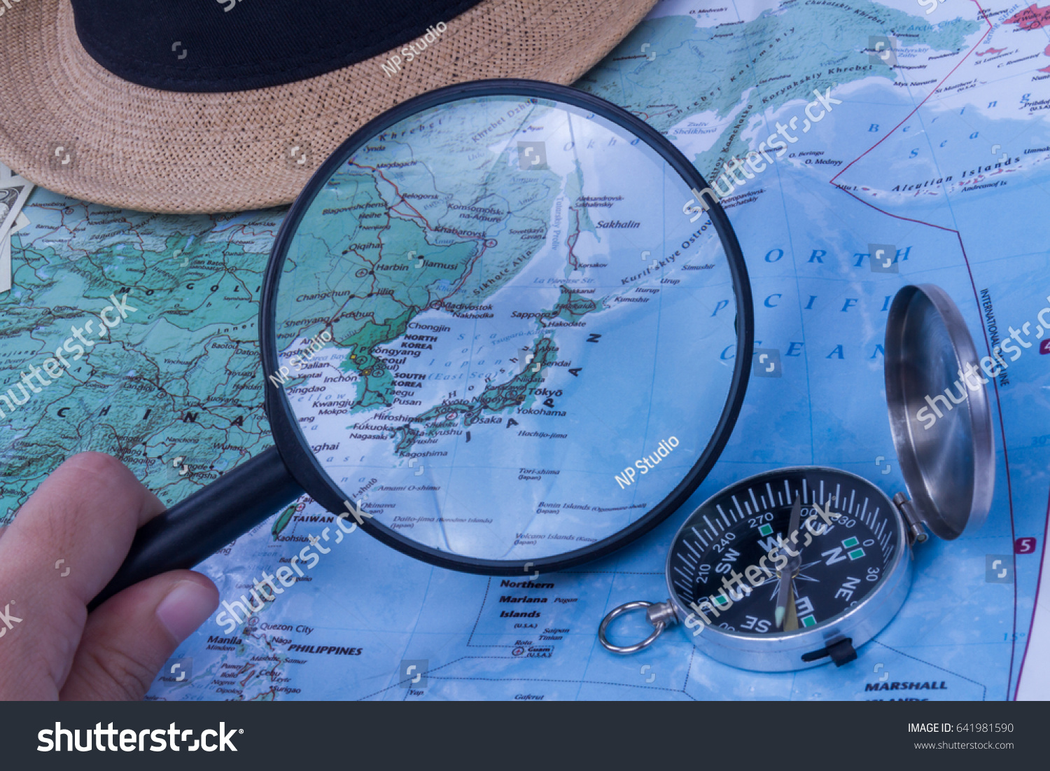 Magnifying glass closeup world map japan stock photo royalty free magnifying glass closeup world map japan stock photo royalty free 641981590 shutterstock gumiabroncs Image collections