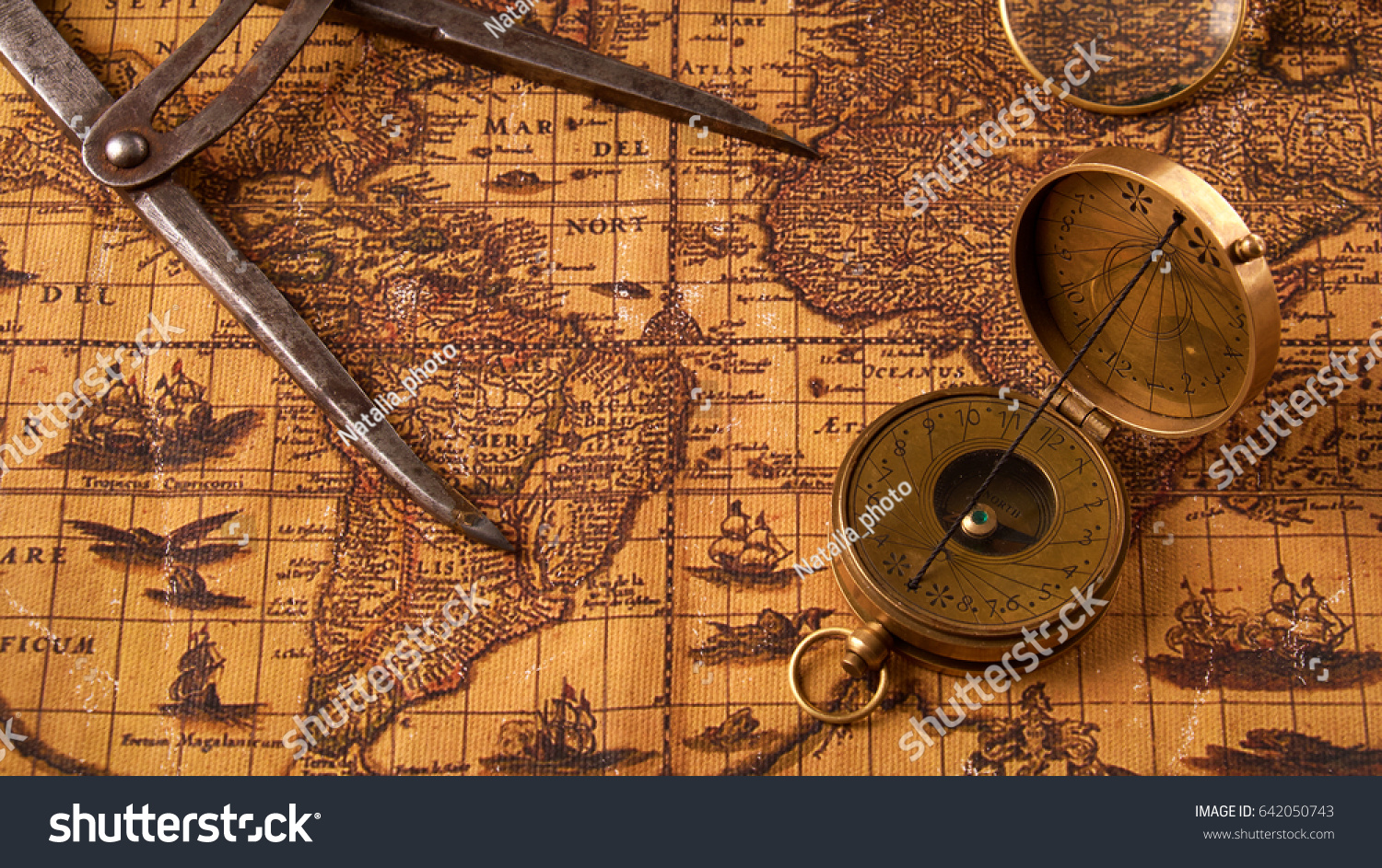 Old vintage retro compass on ancient stock photo royalty free old vintage retro compass on ancient stock photo royalty free 642050743 shutterstock gumiabroncs Image collections