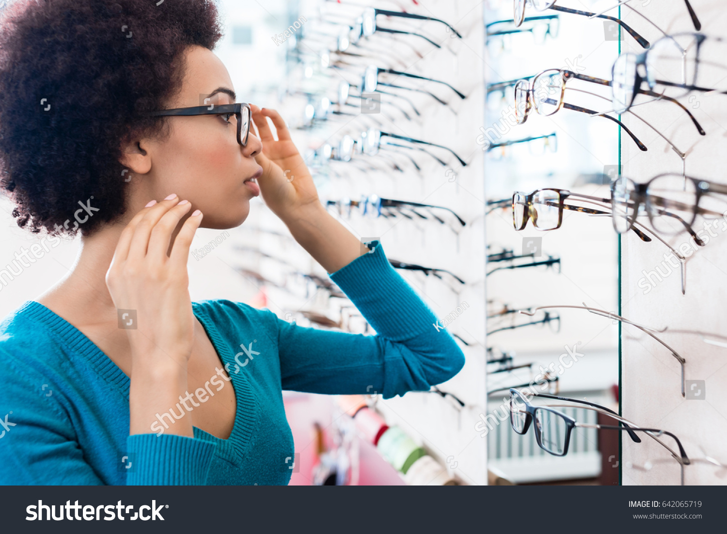 665a4d3684 Black Woman Trying On Glasses She Stock Photo (Edit Now) 642065719 ...