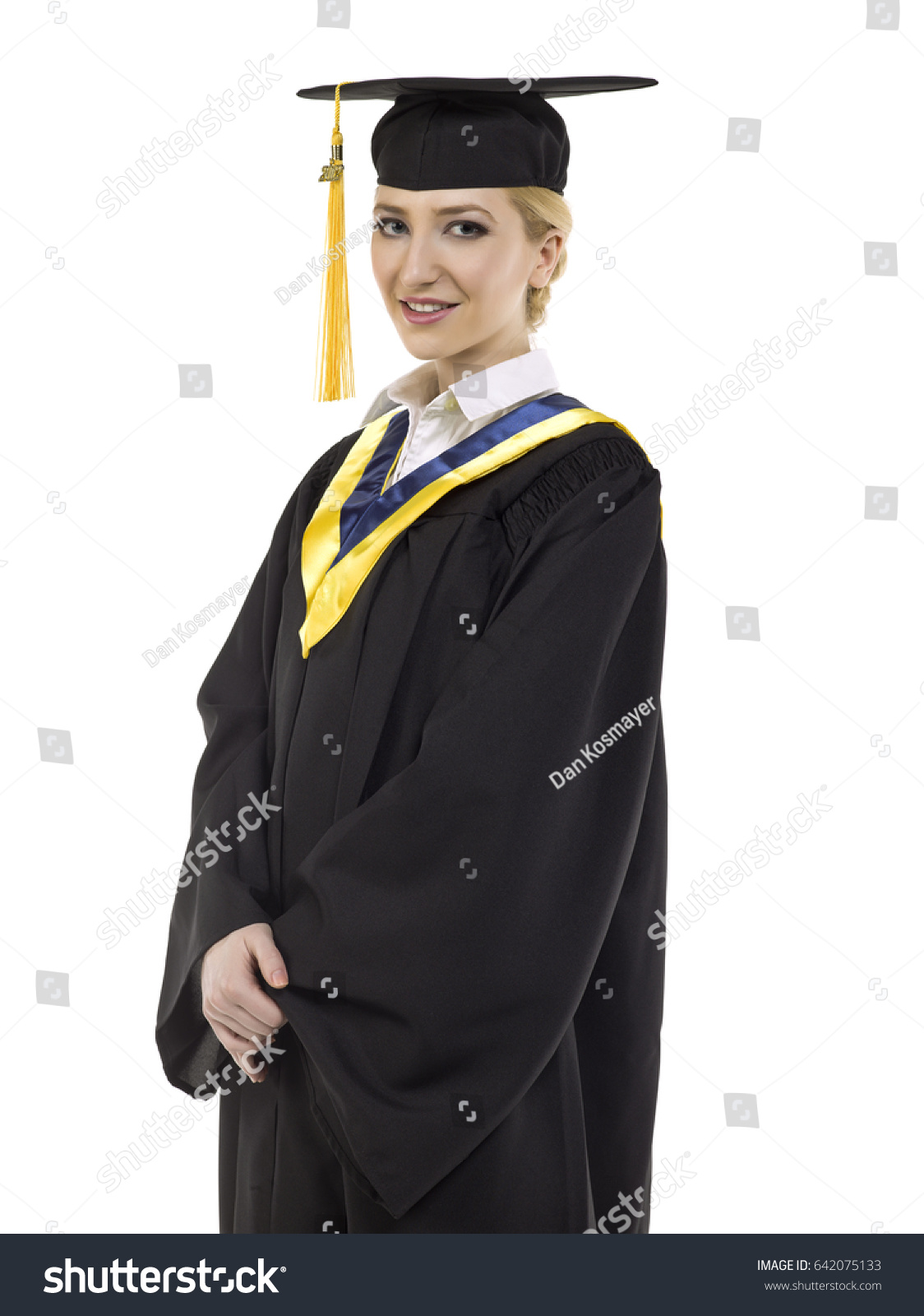 Young women in her graduation gown; isolated on white background ...