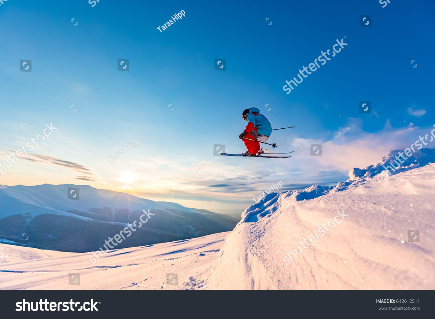 Good skiing in the snowy mountains, Carpathians, Ukraine. Beautiful winter sunset, incredible ski jump. #642612511