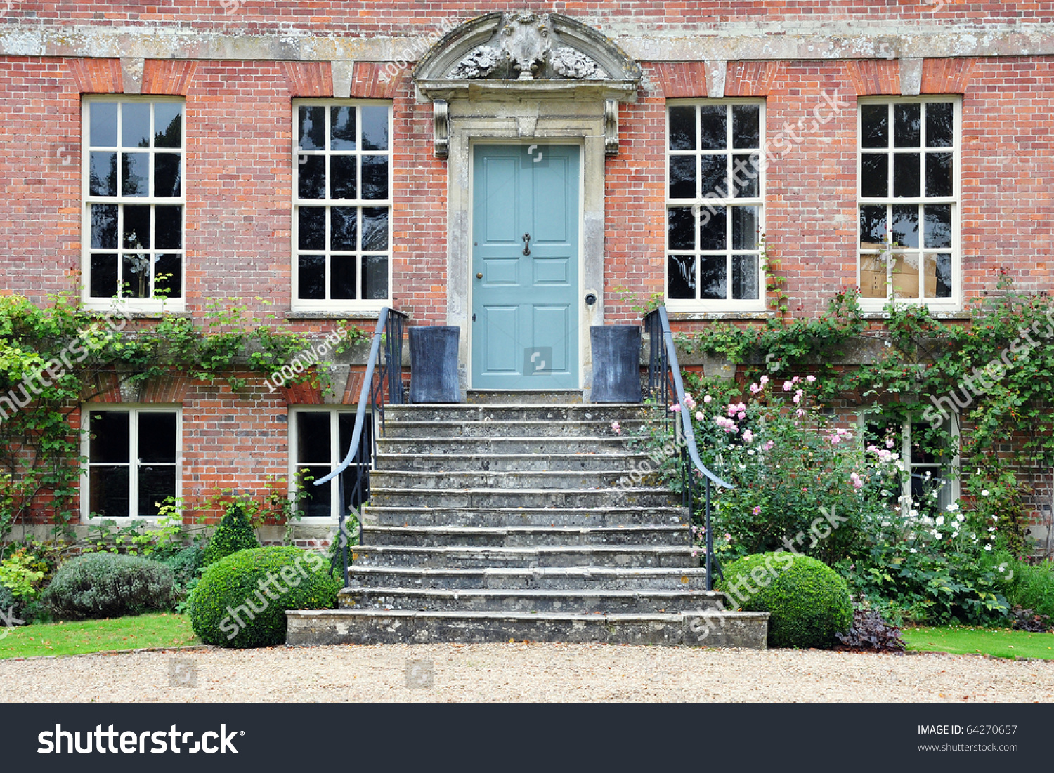 Exterior Of Beautiful Red Brick House Stock Photo 64270657