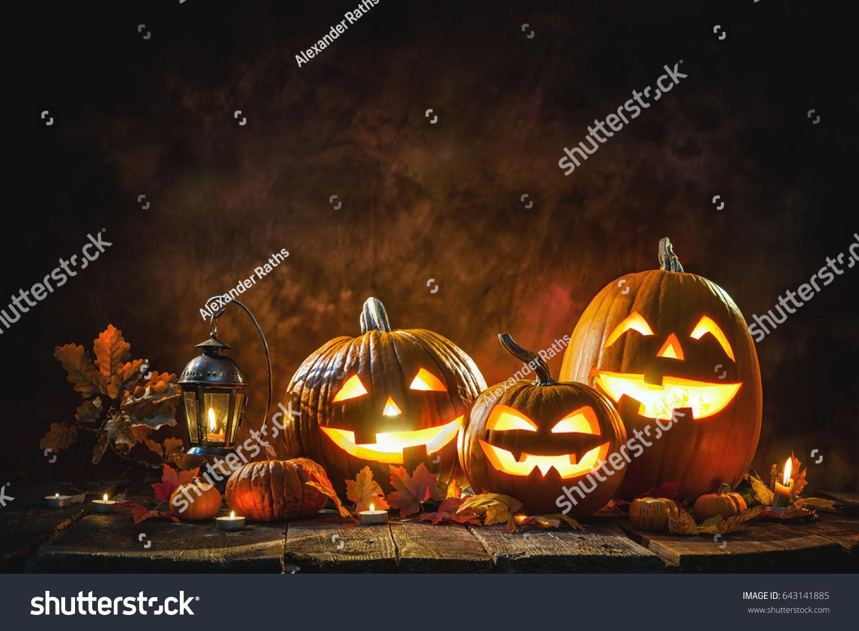 Halloween pumpkin head jack lantern with burning candles #643141885