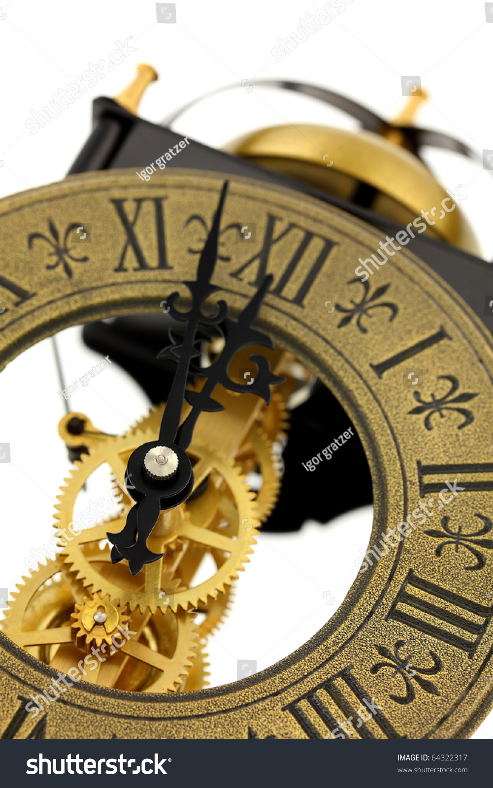 Close Up Of Old Fashioned Wall Clock With Visible Gears