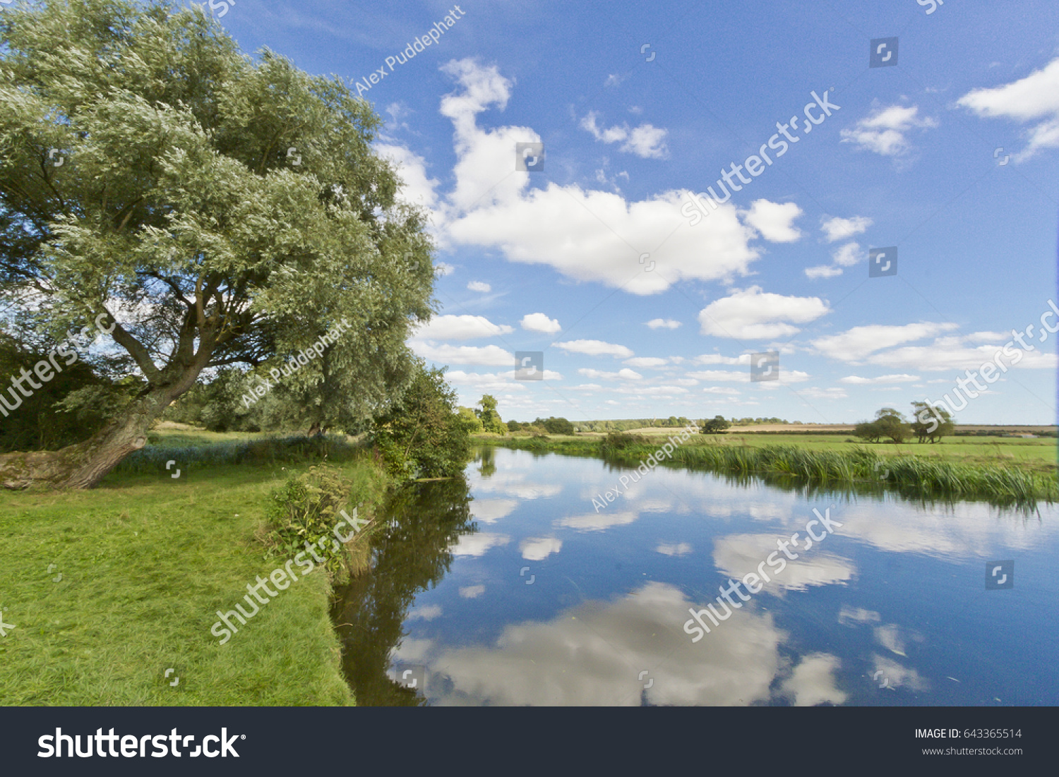 August Skies Reflecting On Still River Stock Photo Edit Now 643365514
