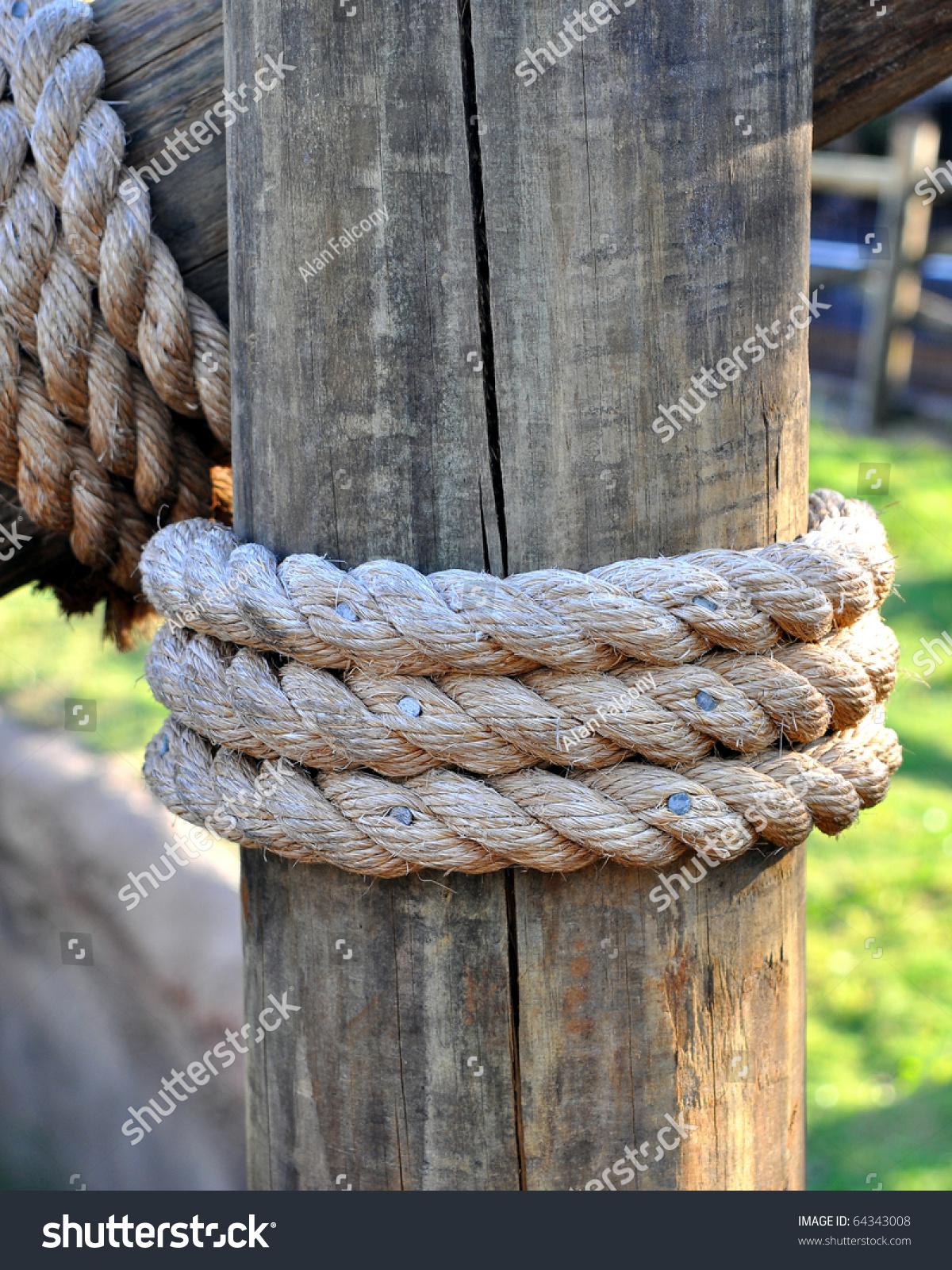 Three Layers Rope Tied Around Wooden Stock Photo 64343008