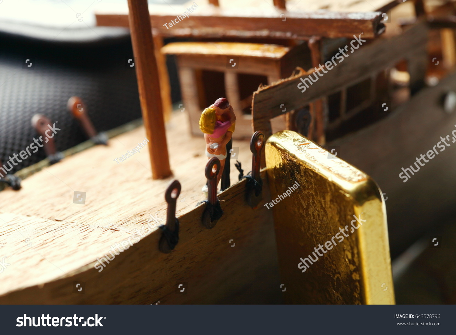 a1a4c9f62e9c Gold bar put beside miniature scratch build junk ship wooden model.