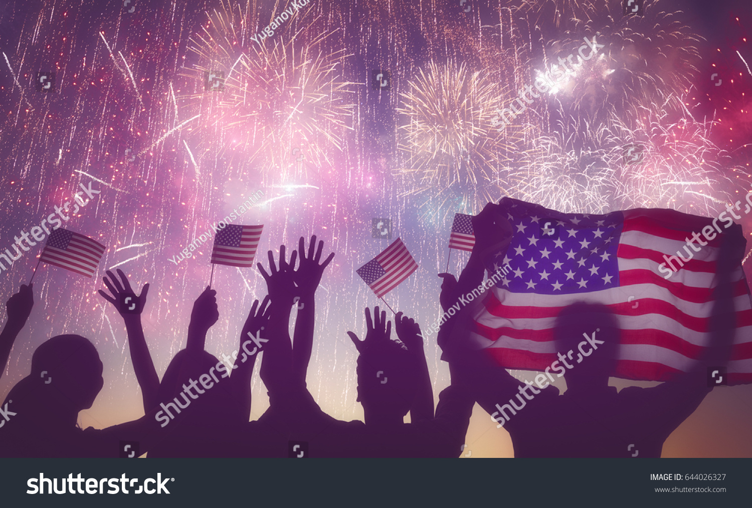 Patriotic holiday. Silhouettes of people holding the Flag of USA. America celebrate 4th of July. #644026327