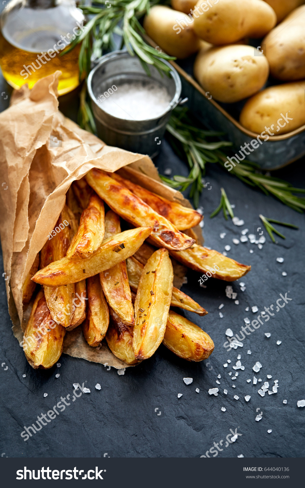 Baked potato fries addition sea salt stock photo 644040136 baked potato fries with addition sea salt and rosemary on a black background top view ccuart Image collections