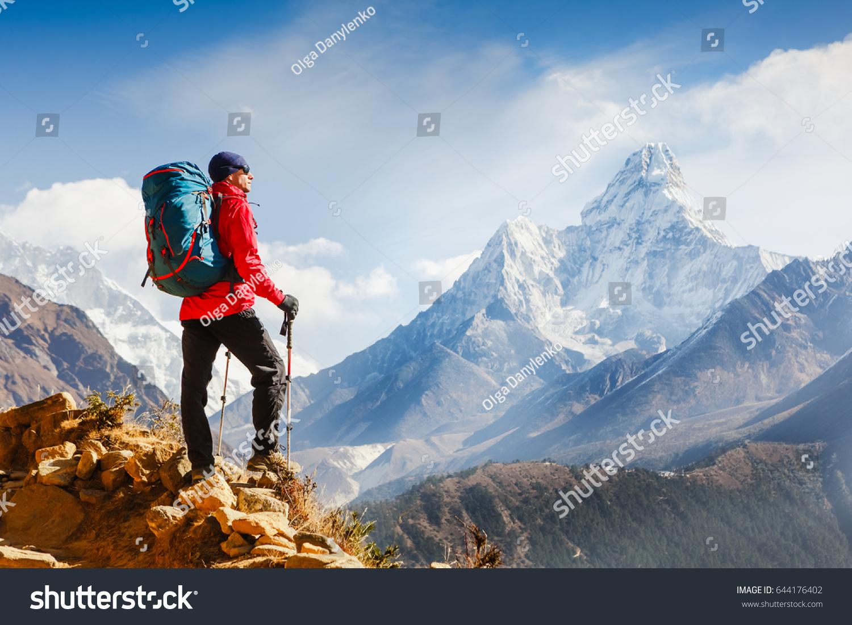 Active hiker enjoying the view. Himalayas. Nepal #644176402