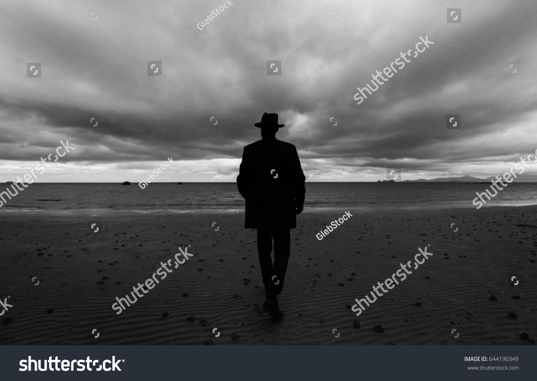 Unusual man on beach black white stock photo edit now 644190349