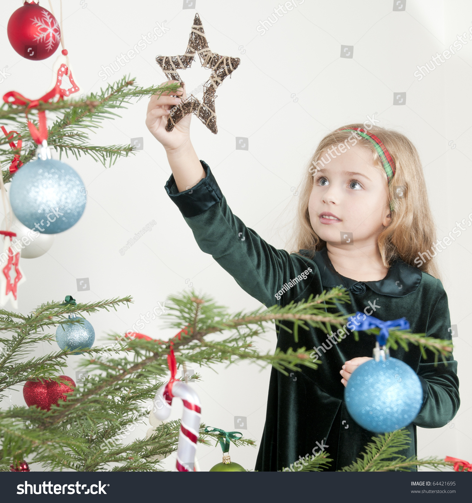 Little Girl Christmas Tree: Little Girl Decorating A Christmas Tree Stock Photo