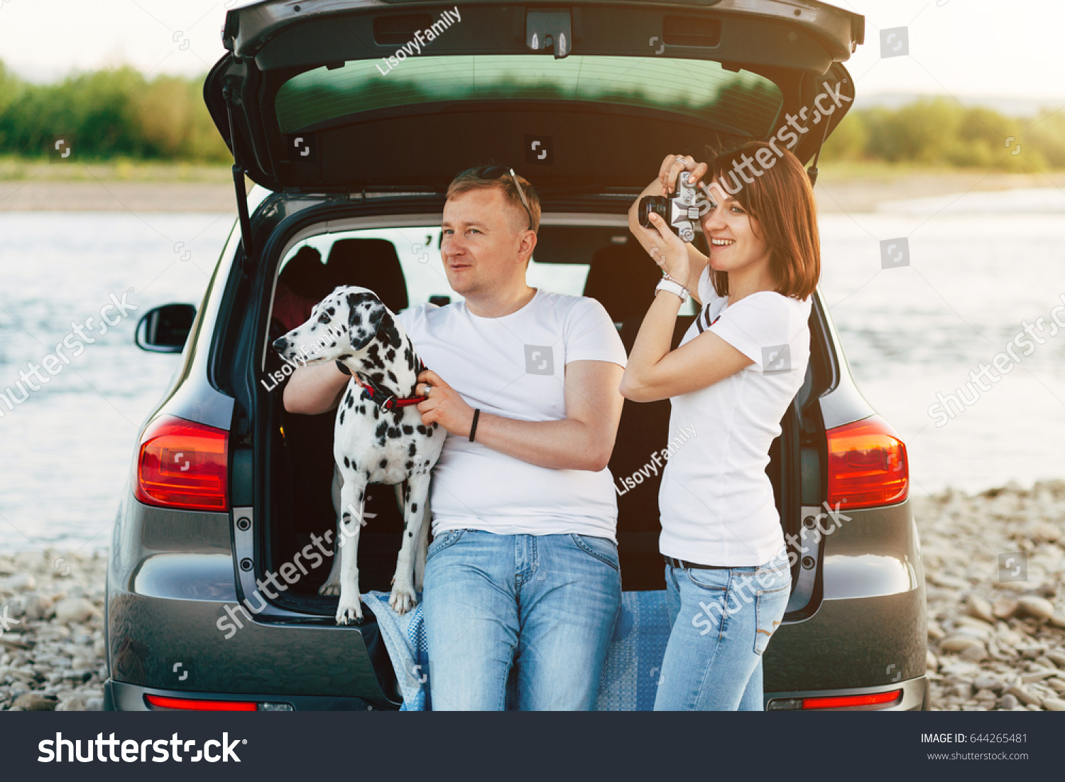 Family Two Person Dog Sitting Car Stock