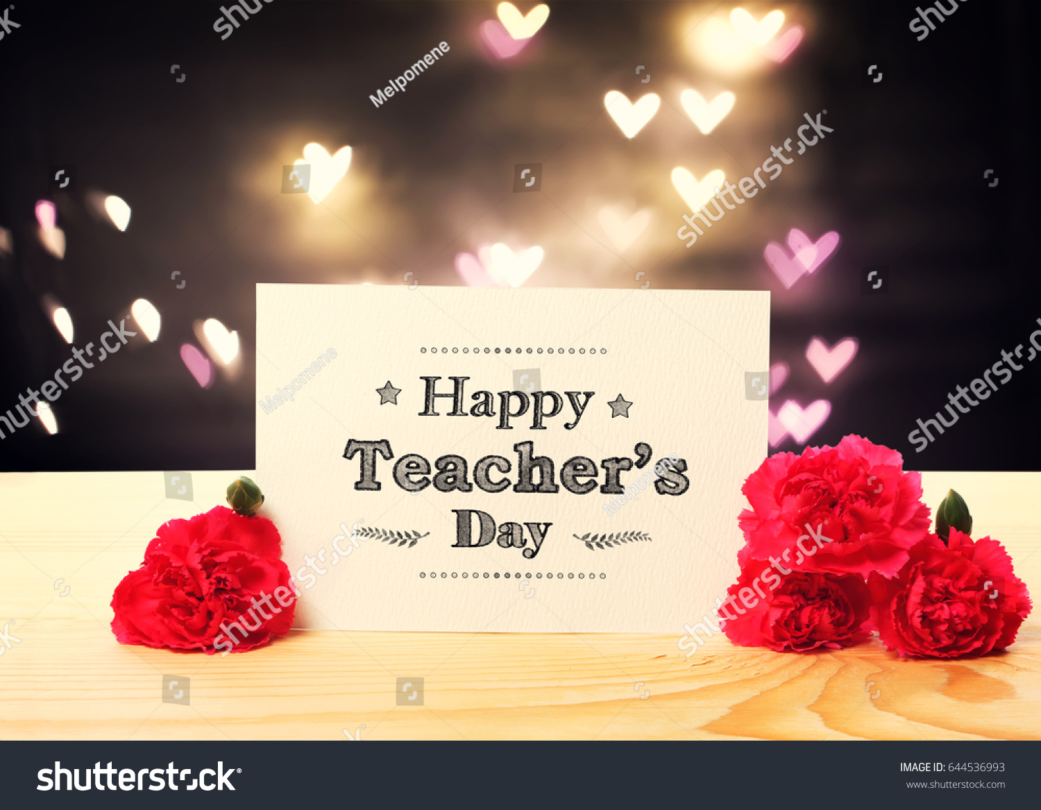 Teachers day message card carnation flowers stock photo 644536993 teachers day message card with carnation flowers and heart shaped lights kristyandbryce Image collections