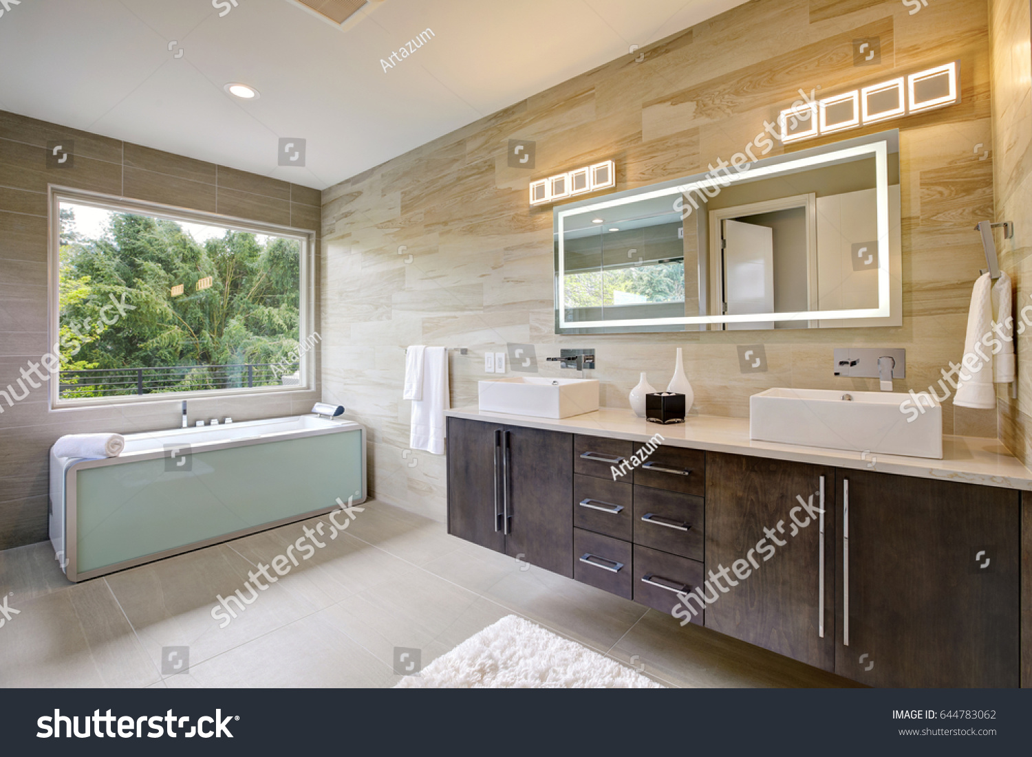 contemporary master bathroom features a dark vanity cabinet fitted with rectangular his and hers sink and