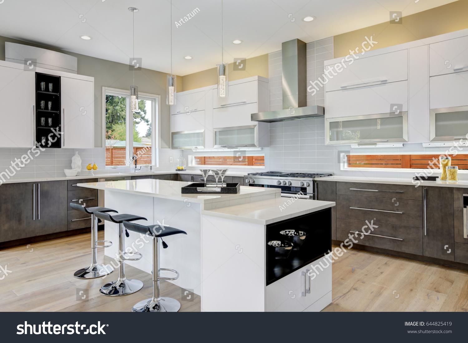 Luxury Kitchen With Natural Backsplash, White Quartz, Natural Brown Wood  Cabinets And Lots Of