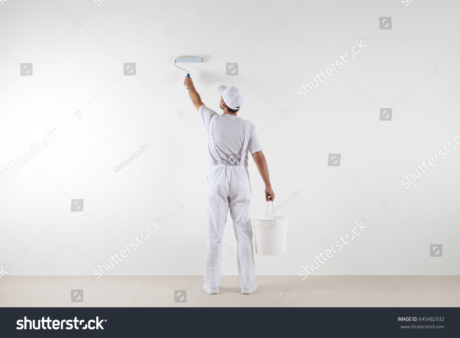 Rear View Painter Man Painting Wall Stock Photo 645482932 Shutterstock