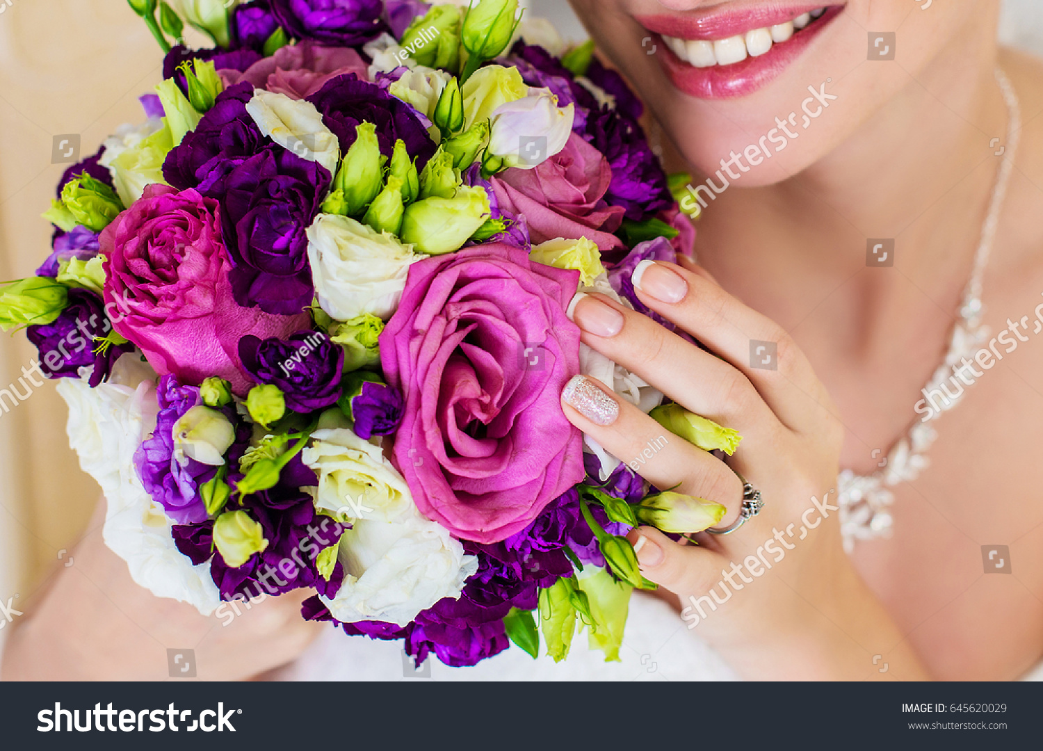 Girl smiles beautiful smile white teeth stock photo royalty free girl smiles a beautiful smile with white teeth bouquet of flowers as a gift for izmirmasajfo Image collections