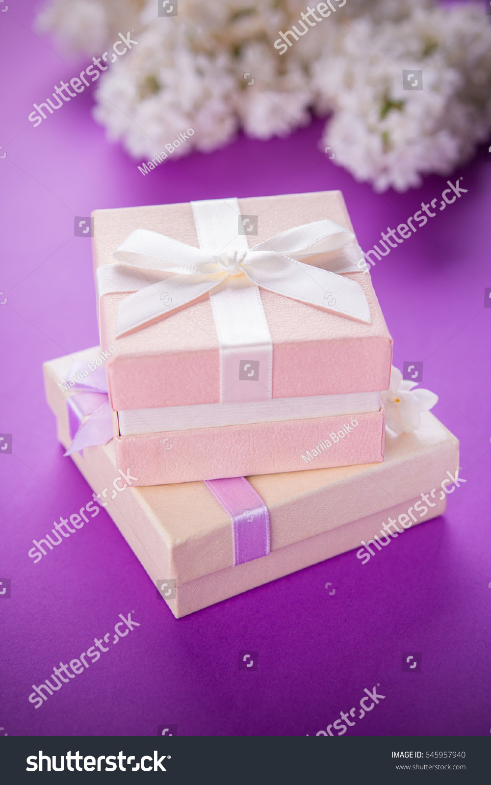 Gift Boxes Flowers On Purple Background Stock Photo (Royalty Free ...