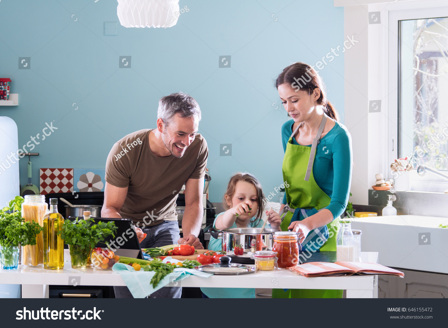 Dad Mom Their Little Daughter Cooking Stock Photo (Royalty Free ...