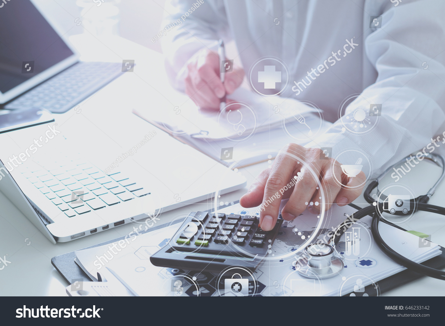 Photo license fee calculator - Healthcare Costs And Fees Concept Hand Of Smart Doctor Used A Calculator For Medical Costs