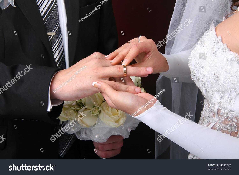 he put wedding ring on stock photo 64641727