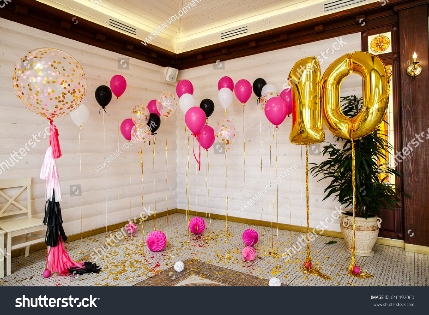 Balls And Balloons In Room Decorated For Birthday Party