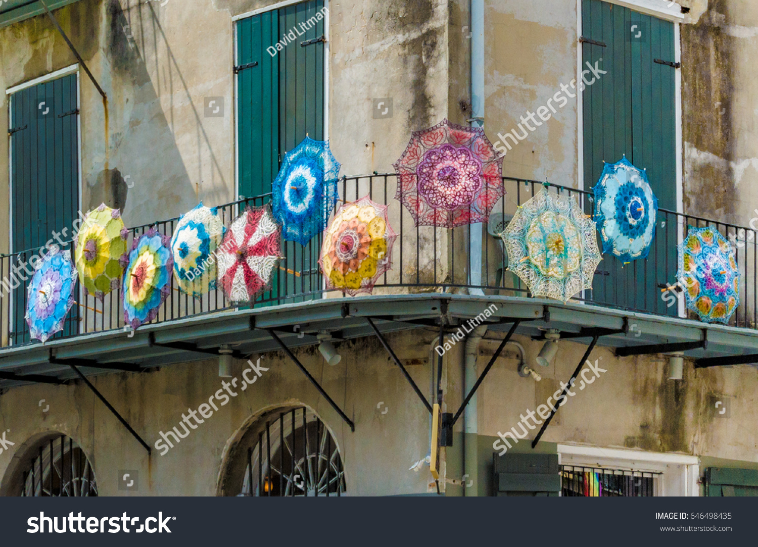 Colorful umbrellas decorate a balcony in the French Quarter of New Orleans, Louisiana.