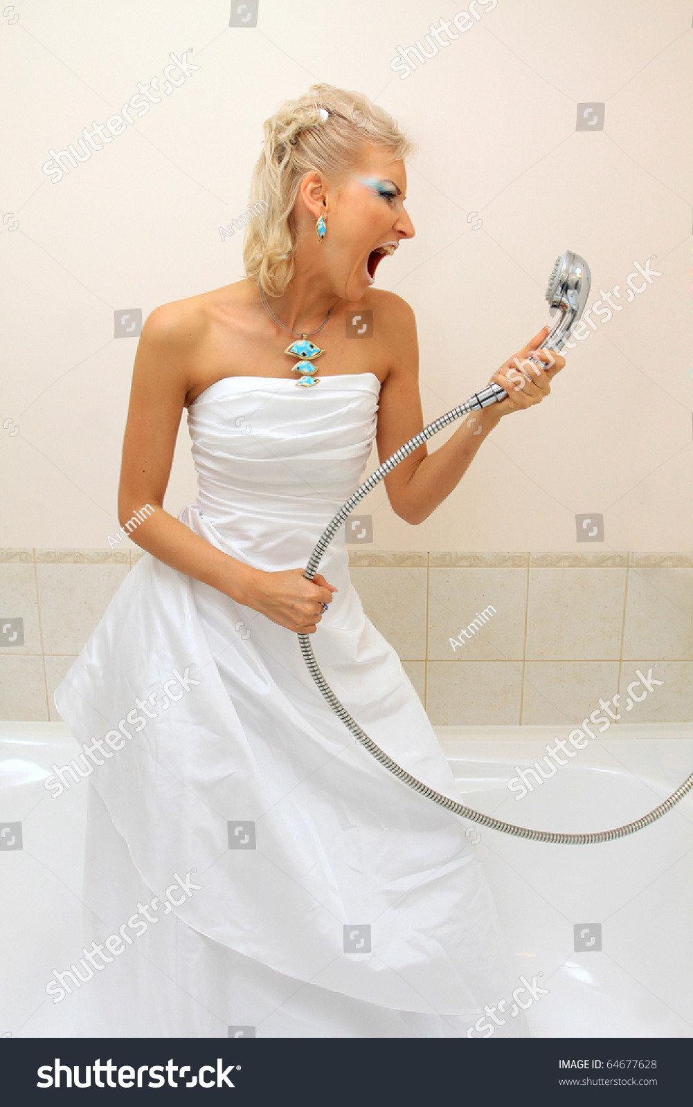 Fashion model wedding dress cries bathroom stock photo for Bathroom dress