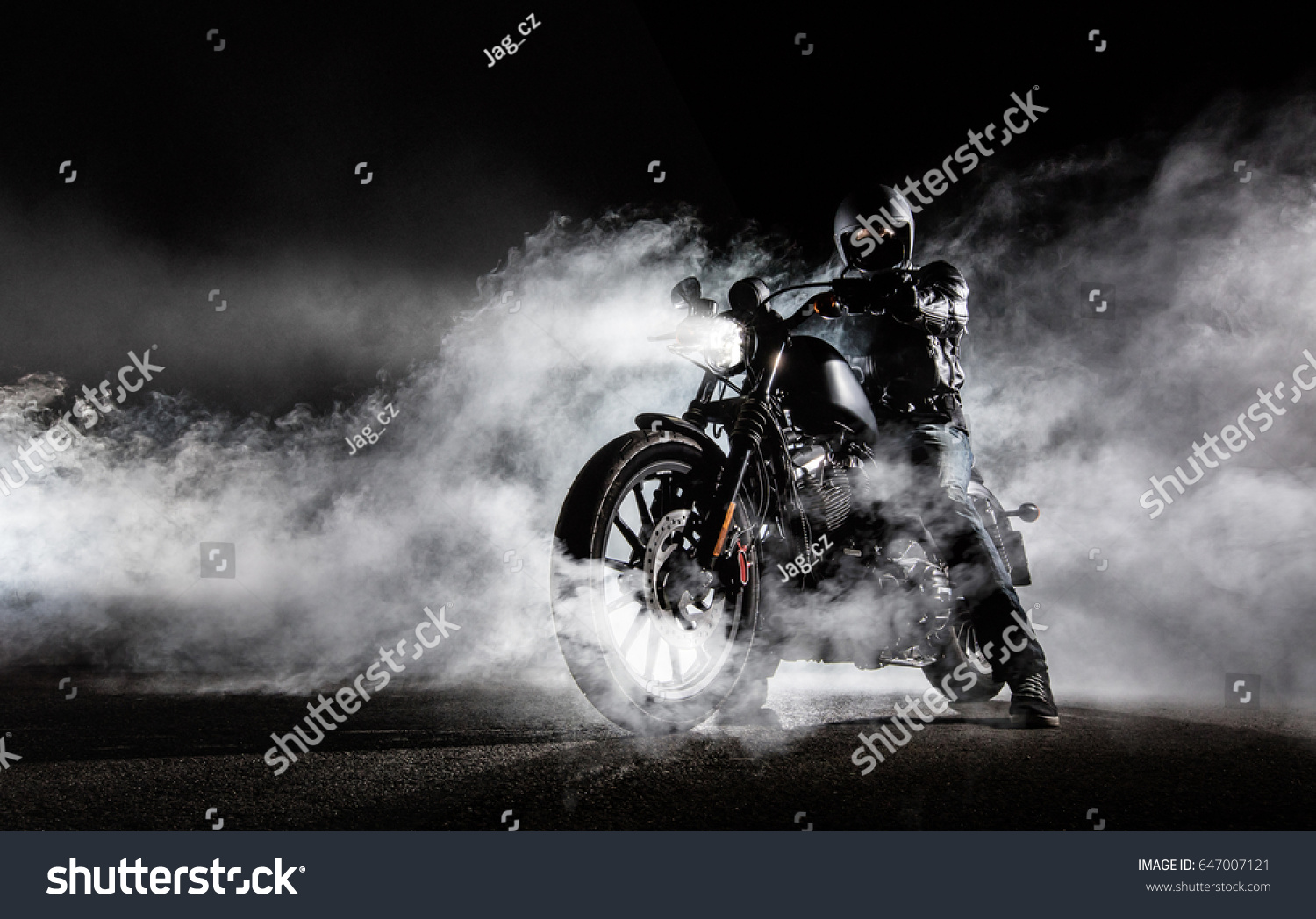 High power motorcycle chopper with man rider at night. Fog with backlights on background. #647007121
