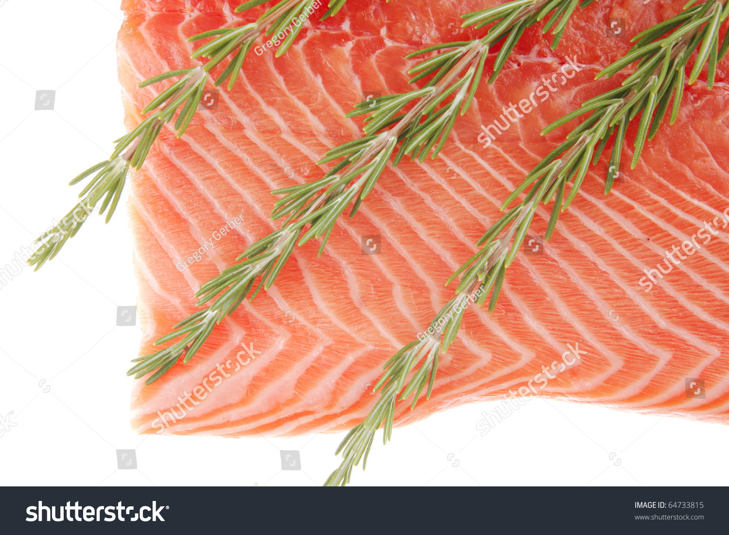 Fresh uncooked red fish fillet and rosemary over white for Red fish fillet