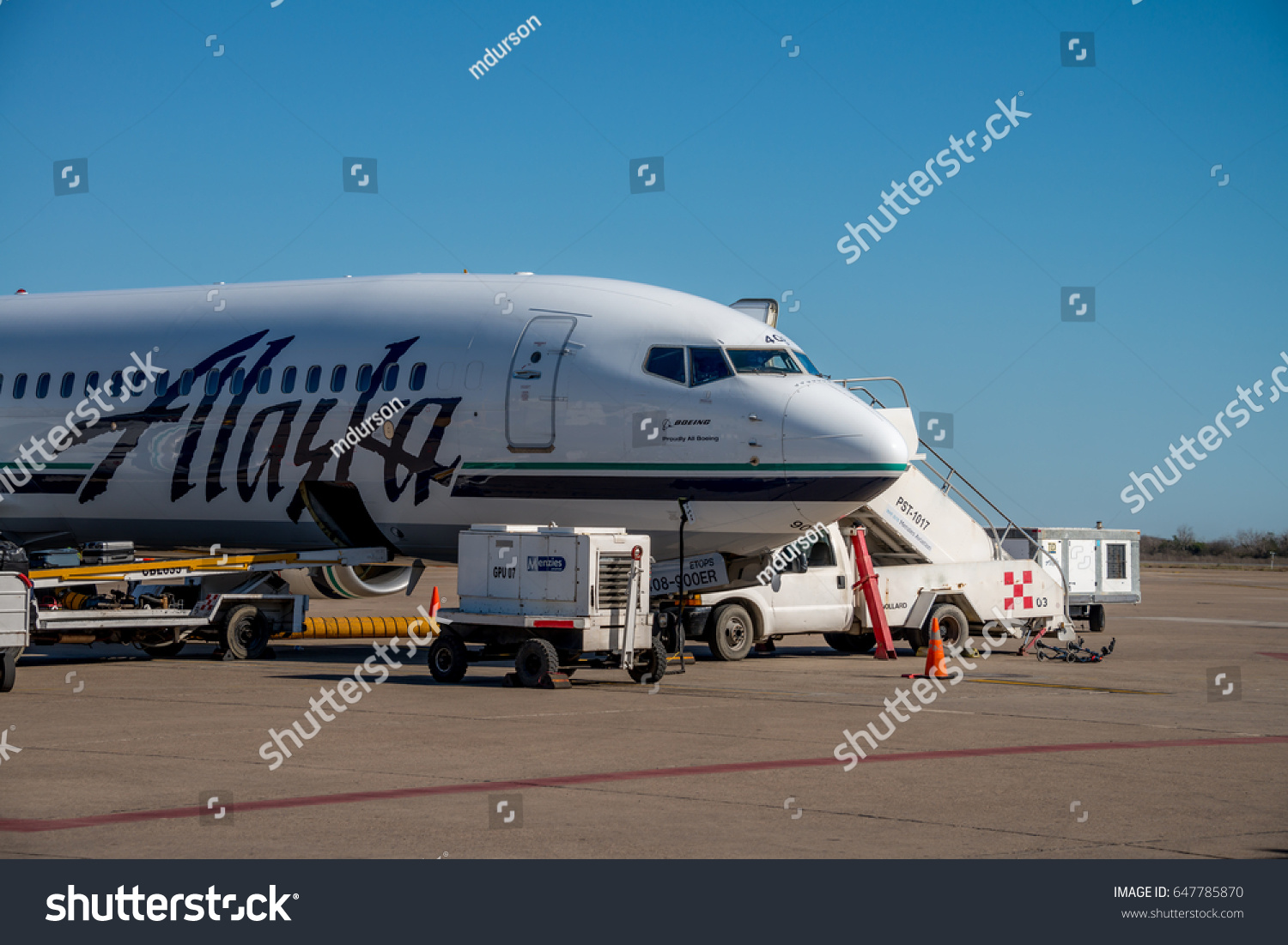 Editorial march 12 2017 alaska airlines stock photo 647785870 editorial march 12 2017 alaska airlines jet on a runway with airport workers buycottarizona Choice Image