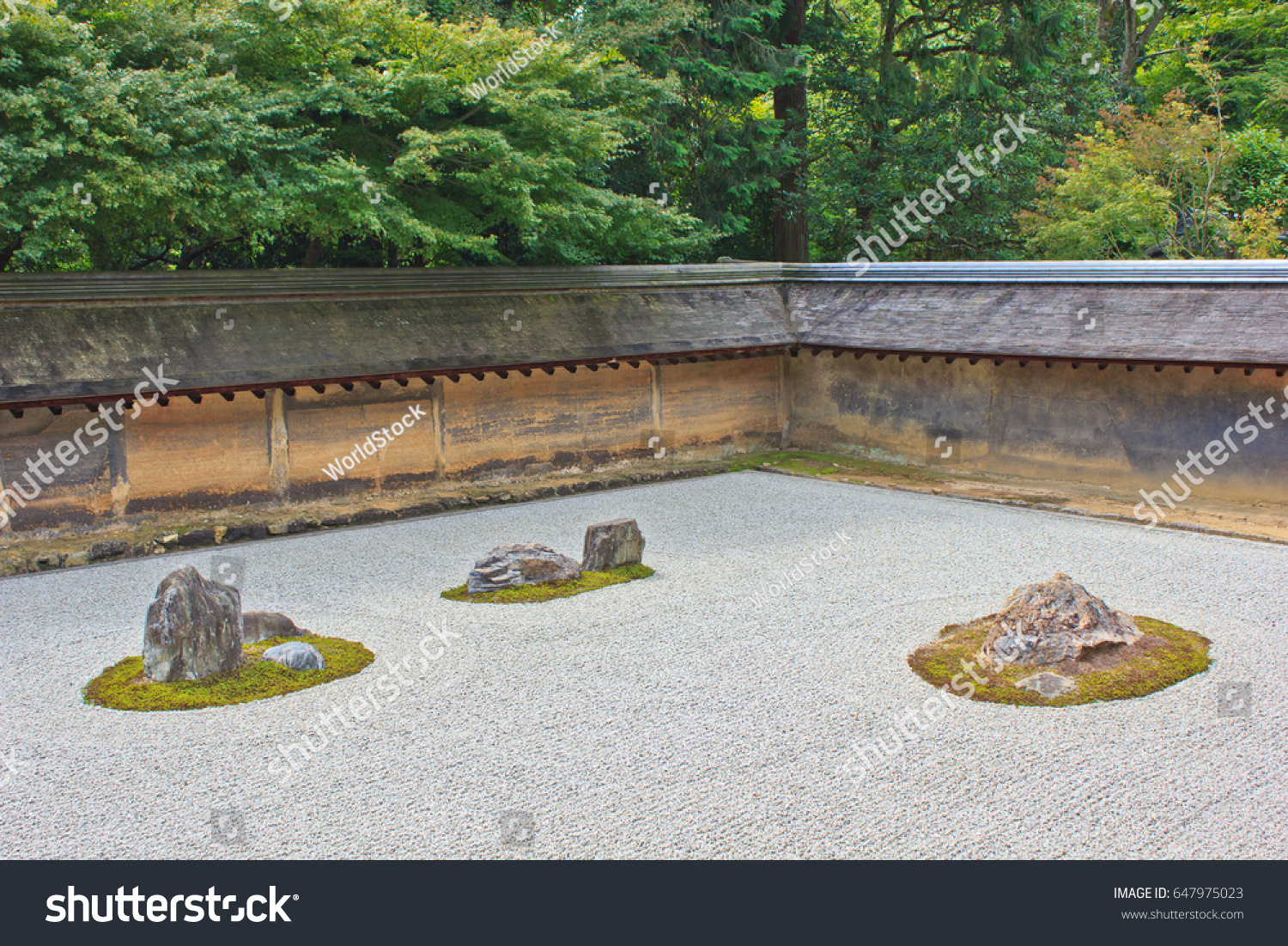 Rocks Representing Mountainous Islands Stand In A Sea Of White Sand In A  Classic Rock Garden