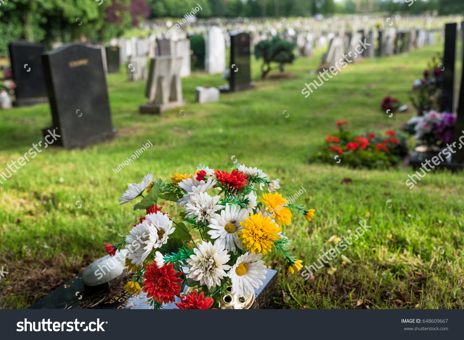 Cemetery Uk Bunch Silk Flowers Foreground Stock Photo Edit Now