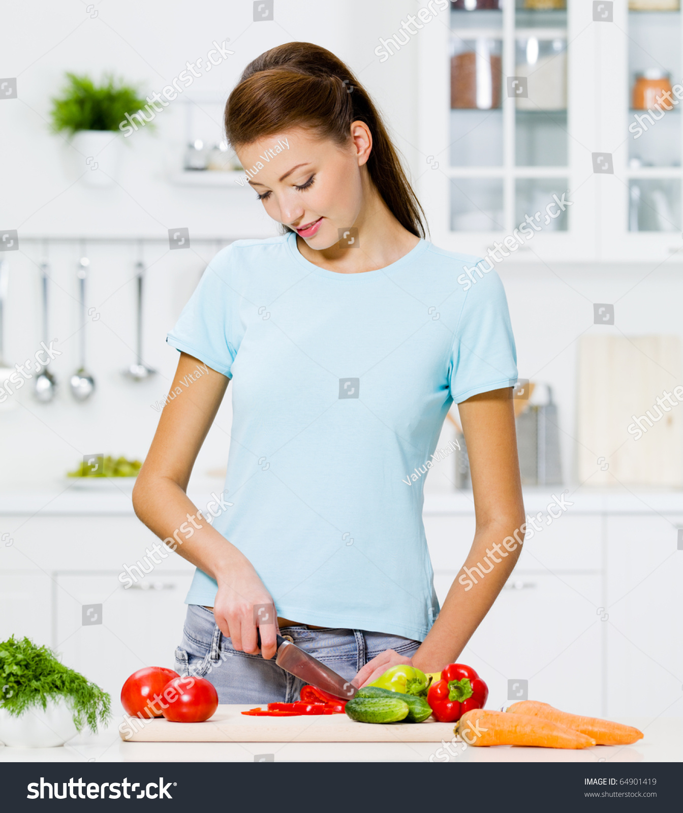 Women Kitchen: Beautiful Woman Cooking Healthy Food In The Kitchen