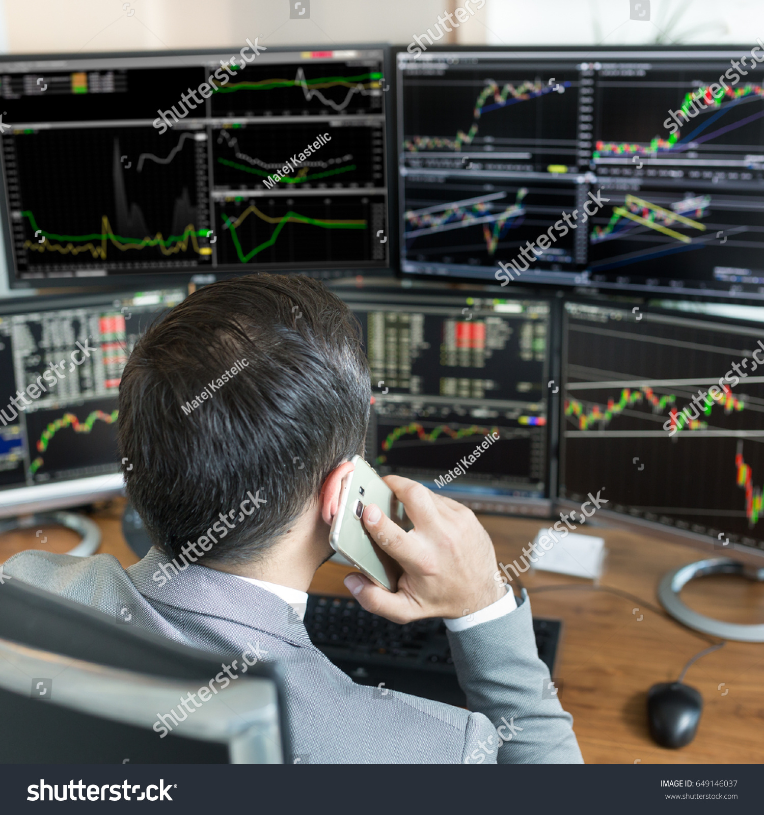 Over shoulder view stock broker trading stock photo 649146037 over the shoulder view of and stock broker trading online while accepting orders by phone geenschuldenfo Image collections