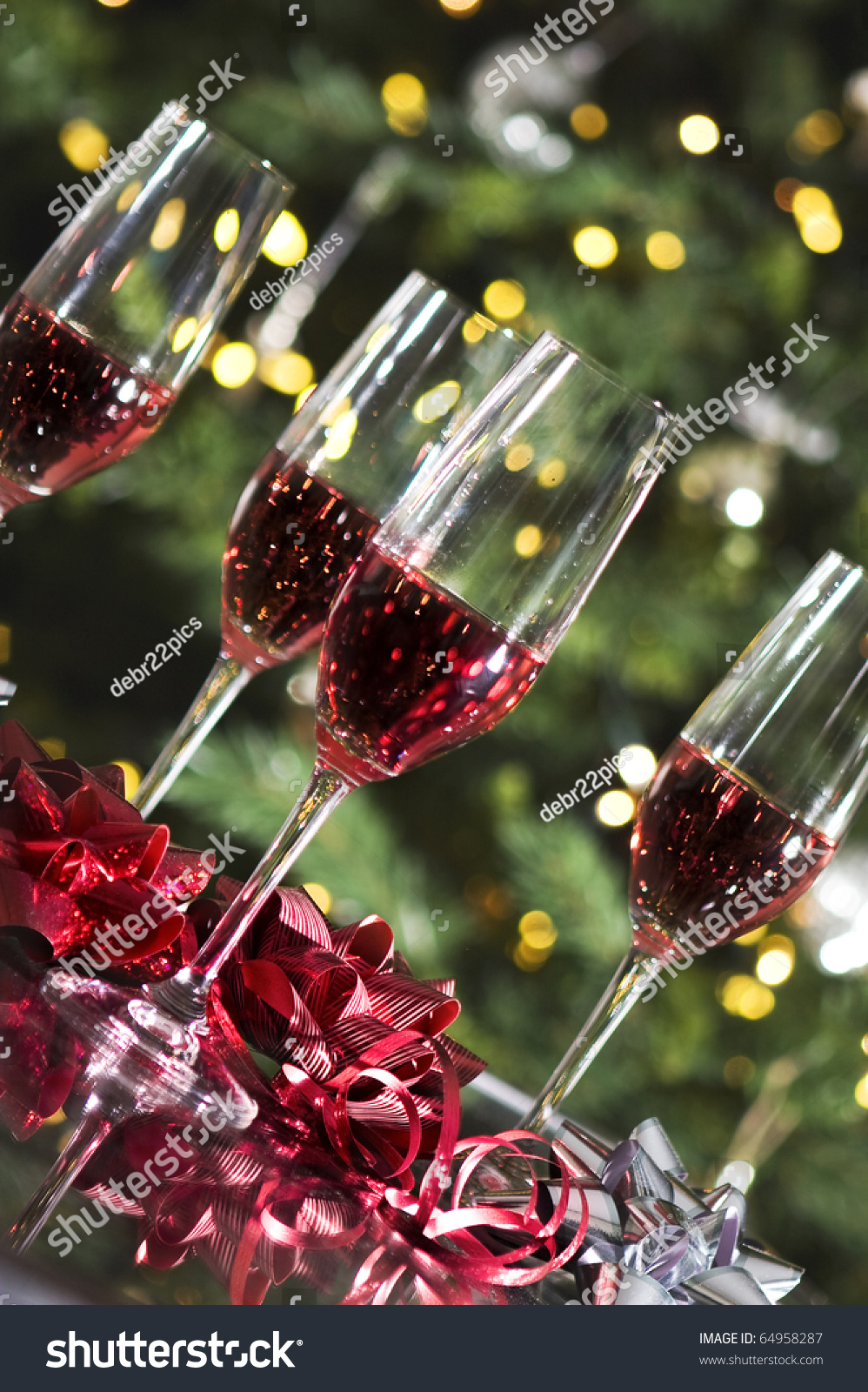 Four Wine Glasses And Red Bows By Christmas Tree Lights Stock Photo 64958287 : Shutterstock
