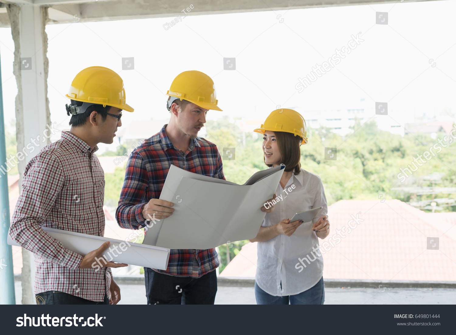 Engineer group worker meeting discussion construction stock photo engineer group and worker meeting discussion with construction blueprint on site workplace malvernweather Images