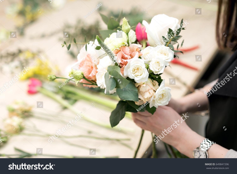 Workshop florist making bouquets flower arrangements stock photo workshop florist making bouquets and flower arrangements woman collecting a bouquet of flowers izmirmasajfo