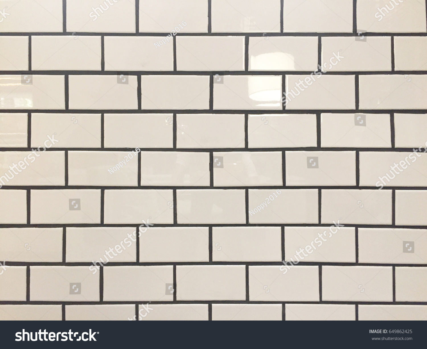 White ceramic tiles brick pattern black stock photo 649862425 white ceramic tiles brick pattern with black grout dailygadgetfo Gallery