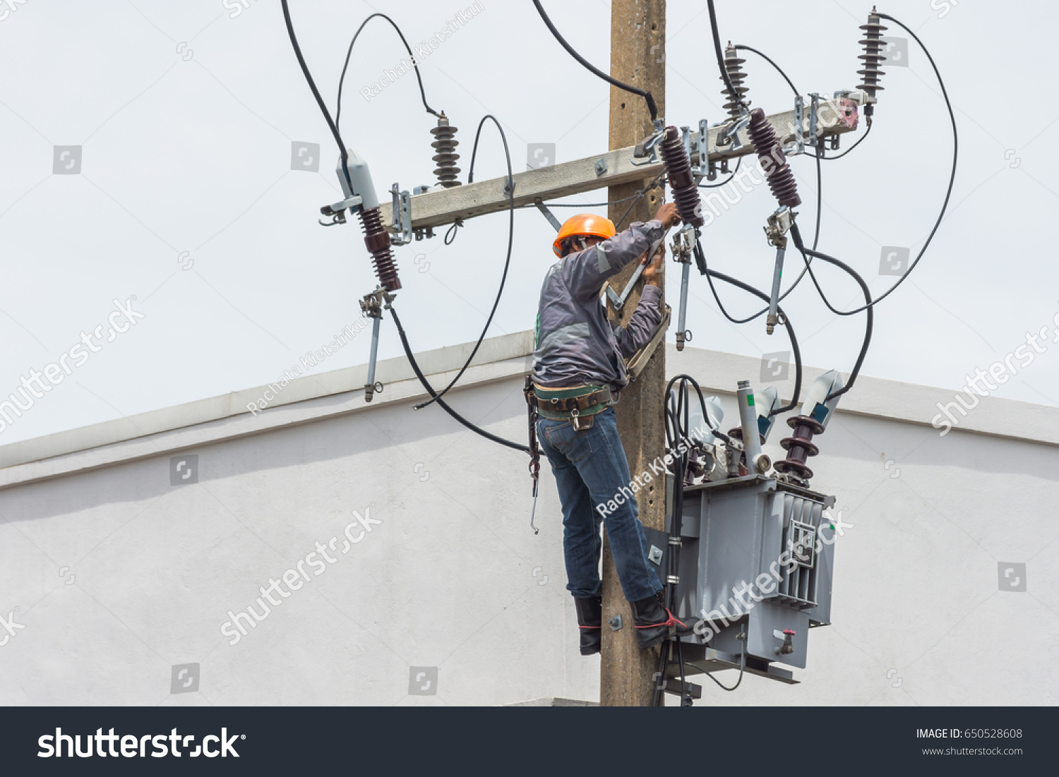 Electric Technician Hardhat Safety Uniform Checking Stock Photo Electrical And Wiring The With Repairing Fixing Wire Fuse Transformer On
