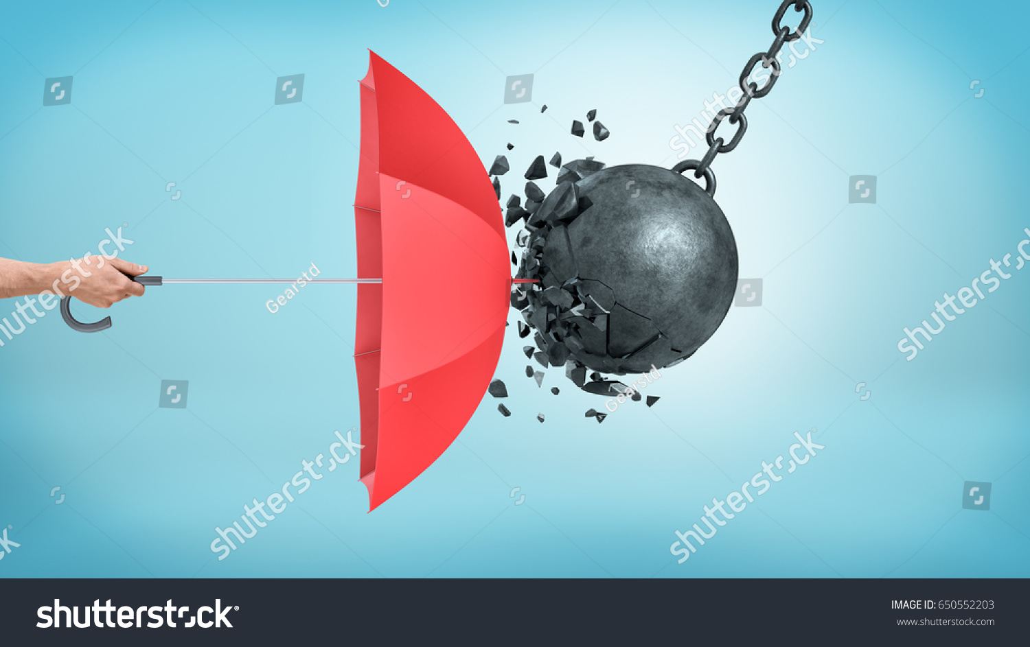A male hand holding an open red umbrella which protects from a collision with a broken wrecking ball. Insurance and protection. Safety measures. IT defense. #650552203
