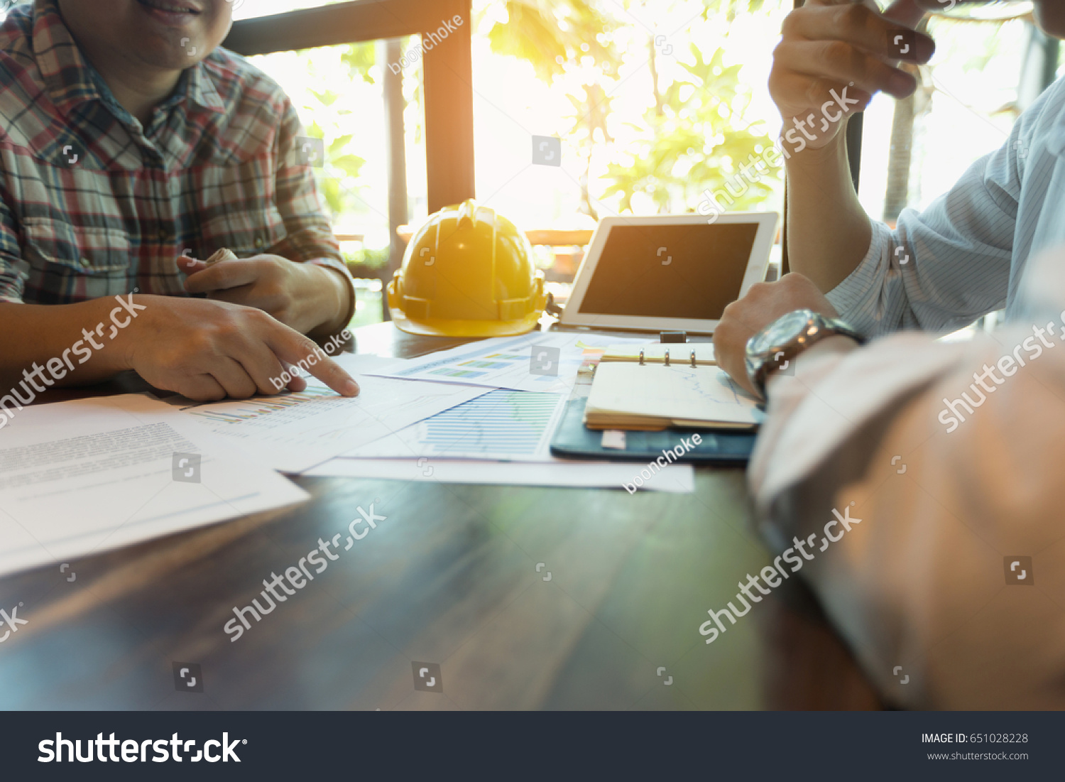 Businessmen are meeting with contractors about business plans. #651028228