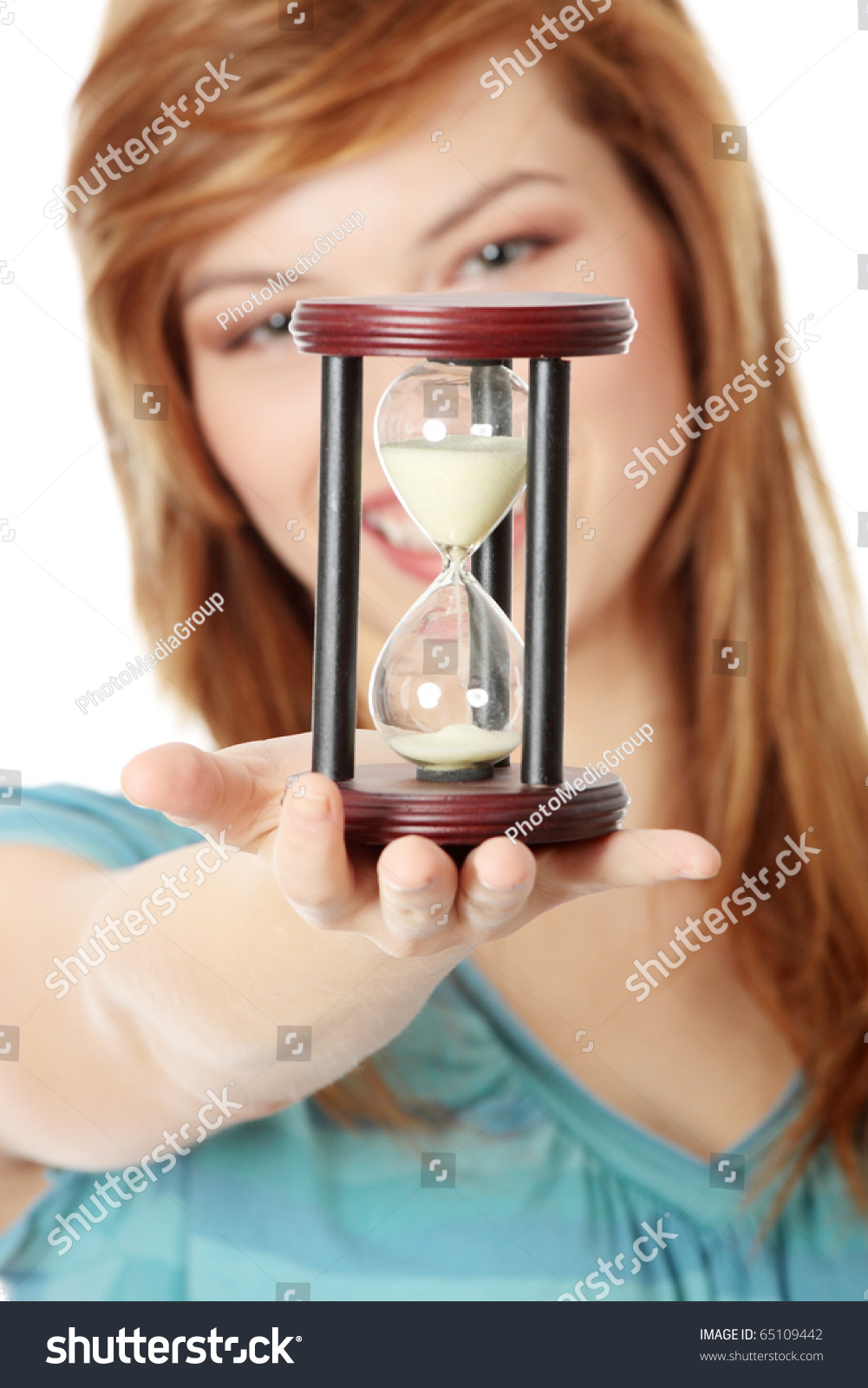 Woman Holding Hourglass On Light Background. Time
