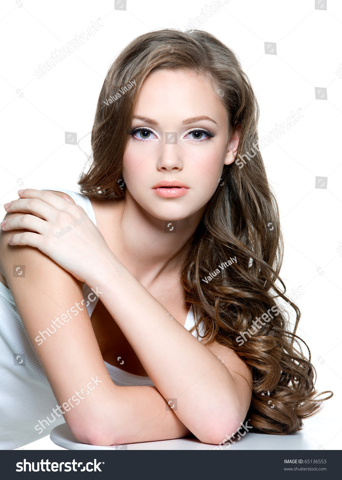 Portrait Of A Beautiful Teen Girl With Long Curly Hairs
