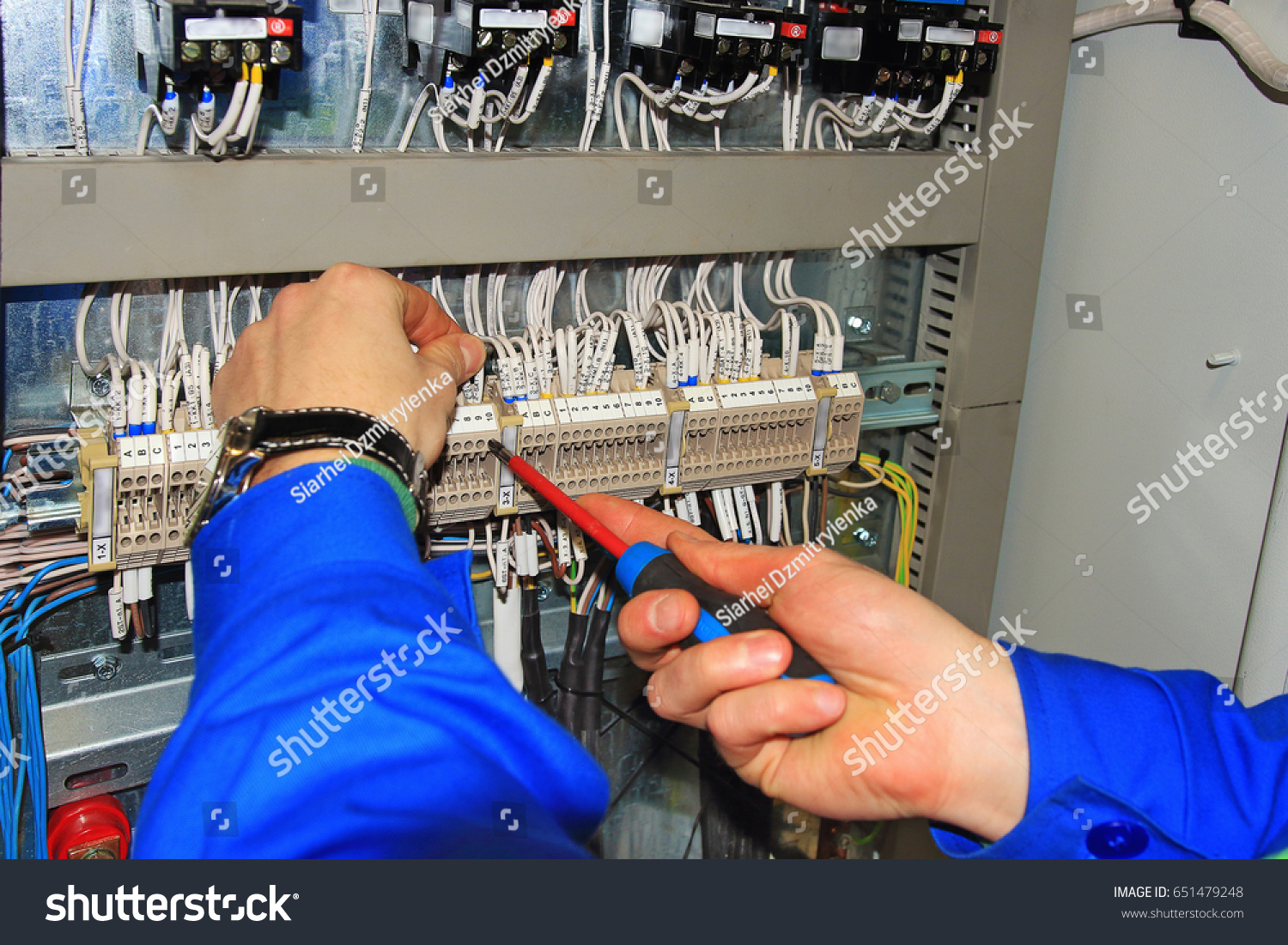 Electricians Hands Screwdriver Macro Connect Wires Stock Photo Edit The With A On Background Of Electrical Cabinet