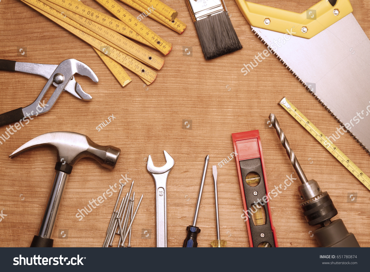 Assorted work tools on wood #651780874