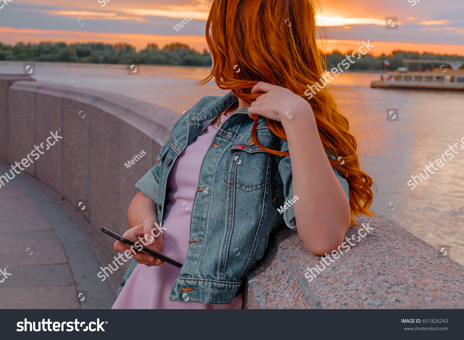 stock-photo-red-haired-woman-with-smartp